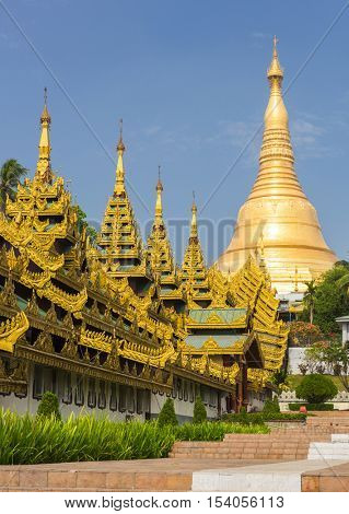 Southern staircase leading to Shwedagon Paya, the most sacred golden buddhist pagoda in Myanmar. Yangon, Myanmar