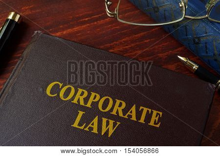 Book with title corporate law on a table.