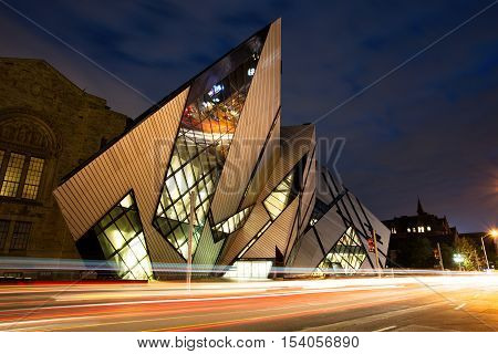 TORONTO - AUGUST 27: The Royal Ontario Museum at night on August 27 2015 in Toronto Canada. The controversial facade of the ROM was designed by architect Daniel Libeskind.