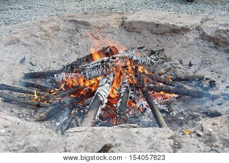 Fire / Tongues of flame embrace the logs