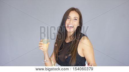 Vivacious woman having fun at a New Year party