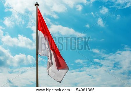 Flag of of Monaco in the background of sky
