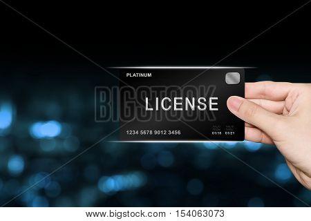 hand picking license platinum card on blur background