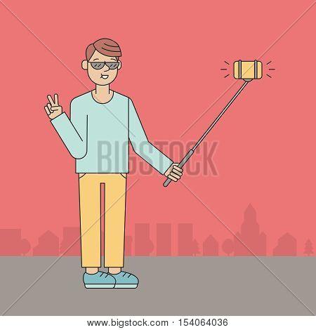 Young man make selfie on the street using selfie stick. Outline design.