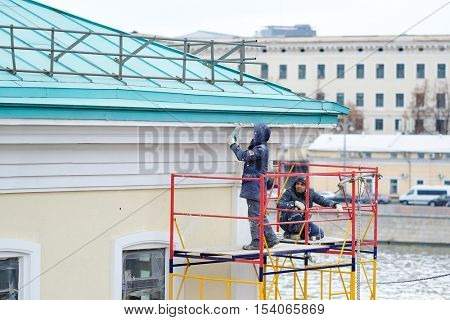 Moscow, Russia - October, 16, 2016: workers restore a house in thecenter of Moscow, Russia