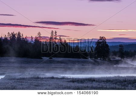 a beautiful  sunrise along the madison river in Yellowstone National park