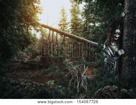 Horror undead woman looks out from behind a tree.
