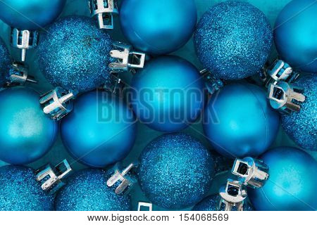 Christmas Time Background Some bright blue sparkle and matte Christmas ball ornaments background