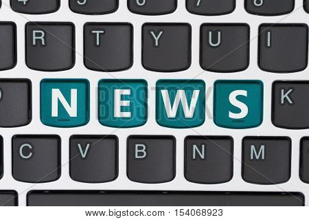 Getting your news online A close-up of a keyboard with teal highlighted text News