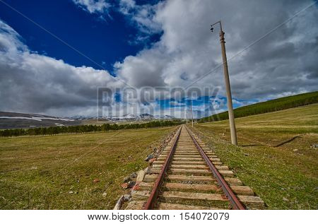 Vintage Railway track in Georgia leadin towards horizon