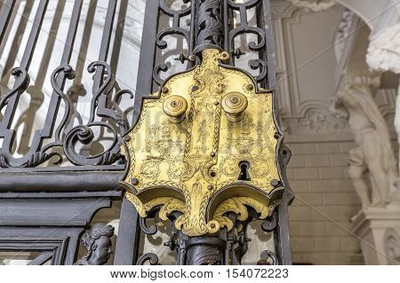 VIENNA AUSTRIA - JUNE 25 2016: Metal gate with lock Detail of Winter Palace (Stadtpalais) of Prince Eugene Savoy is an important high baroque palace in Vienna. It was constructed 1695 - 1724.