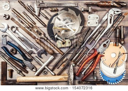 Tool background. Old vintage metal tools collection on wooden workbench. Copy space. Top view flat lay