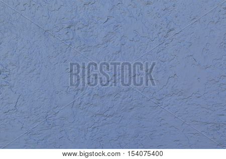 Blue stucco wall forms an irregular pattern that can be used for backgrounds.
