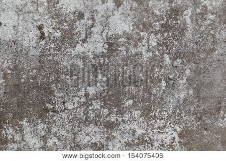 An old cement wall forms an irregular pattern that can be used for backgrounds.