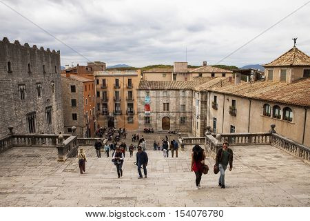 GIRONA,SPAIN - OCTOBER 12, 2016 : tourists climbing the stairs to Cathedral of Saint Mary in Girona, Catalonia, Spain.