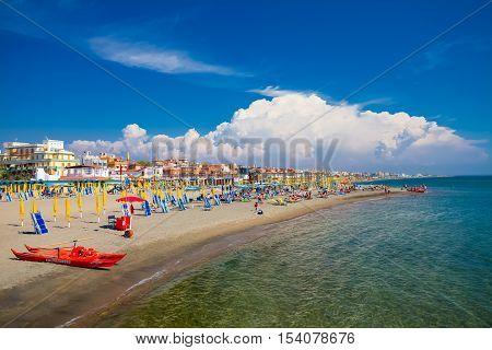 Lido di Ostia ITALY - September 14 2016: Swimming and relaxing people on the beautiful beach Lido di Ostia ( Lido di Roma) private beach Battistini Italy.