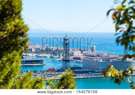 Cable car against the background of the city of Barcelona. View from Montjuic mountain to the city and Yacht port.