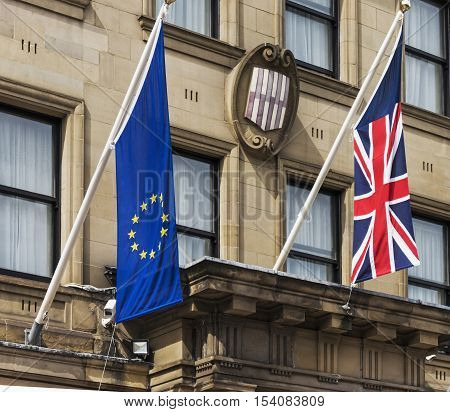 Newcastle/Uk-August 05 2016 as Britain prepares to leave the European Union Euro and Union Jack flags fly together over UK buildings.