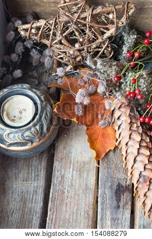 Old christmas decoration. Candle, star and cone. Place for text