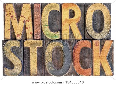 microstock photography concept - isolated word abstract in vintage letterpress wood block type, stained by color ink