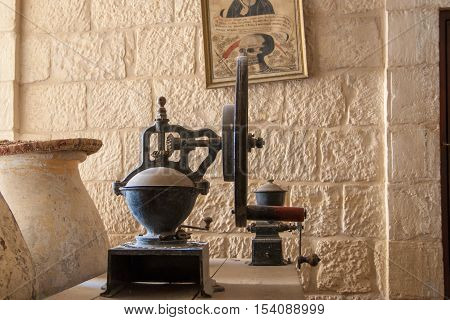 ST. GEORGE MONASTERY ISRAEL - JANUARY 10 2010: vintage grain mill in St George Orthodox Monastery located in Wadi Qelt Israel