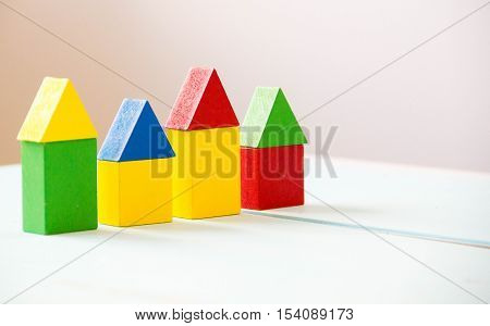 House made of old cubes. Wooden colorful building blocks. Vintage childrens toys. the concept of building a house, apartments
