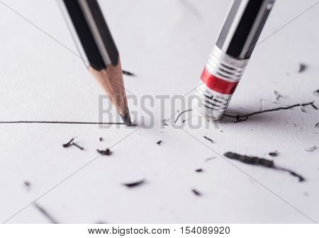 Write and erase Close up of a sharpened pencil writing a straight line