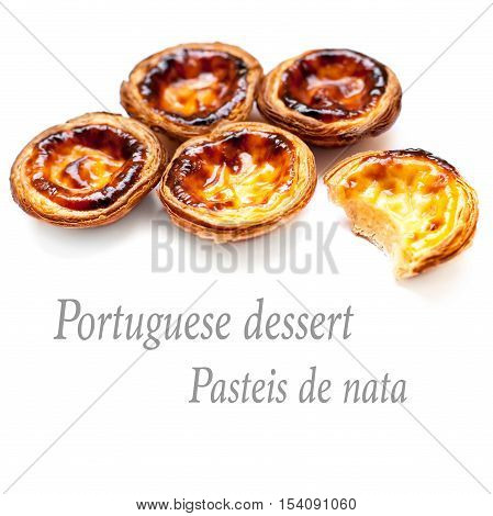 Pastel de Belem - Portuguese egg tarts pastry isolated on white background. Heap of Pastel de nata macro