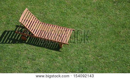 Easy chair on a lawn shot from above