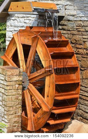 A water wheel on the side of a building