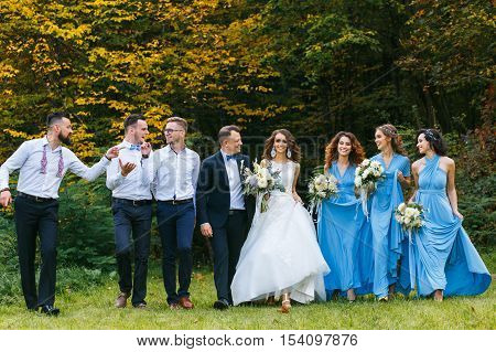 Groomsmen and bridesmaids walking on wedding ceremony