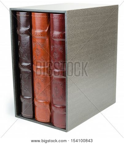 The pile of three photo albums in box on white isolated backround. Photo albums isolated