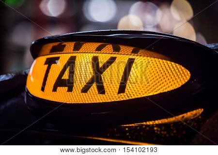 Closeup of yellow Taxi sign in Scotland