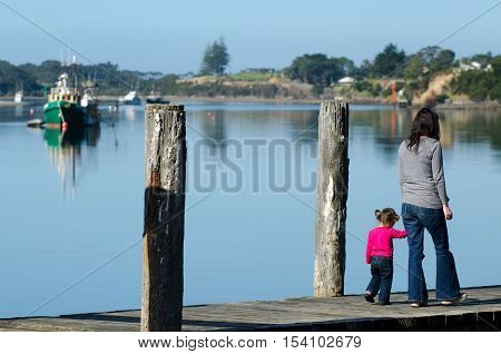 Mother And Child On A Wharf