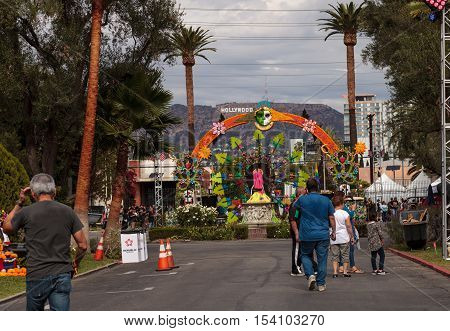 Los Angeles, CA, USA - October 29, 2016: Flower and skeleton arch entrance to Dia de los Muertos, Day of the dead, in Los Angeles at the Hollywood Forever Cemetery grounds. Editorial use only.