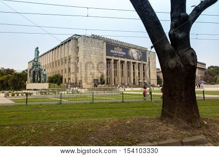 Krakow Poland - October 2 2016: Building the National Museum in Krakow with a big poster advertising the exhibition: Mary Mother of Mercy MMM