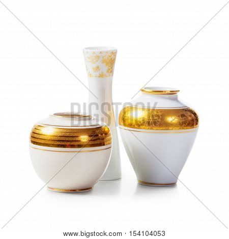 Three antique white porcelain vases on white background. Small objects group clipping path included
