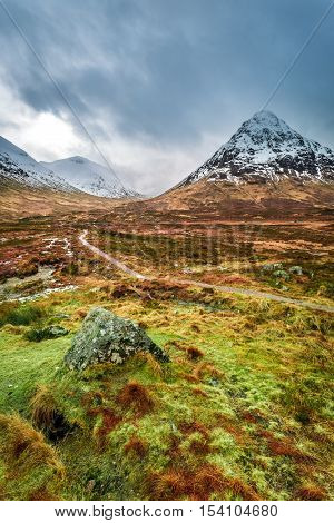 Snow Capped Mountains And A Path In Glencoe