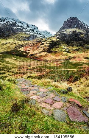 Mountain Path Leading To The Peak In Scotland