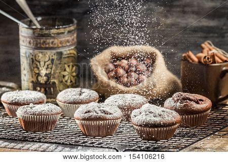 Falling Icing Sugar On Fresh Chocolate Muffins