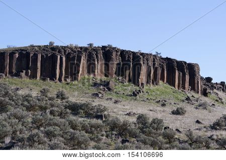 Jagged rock columns stand like pinnacles against a blue sky.