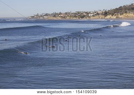 Surfers in the water at Pacific Beach  in San Diego, California
