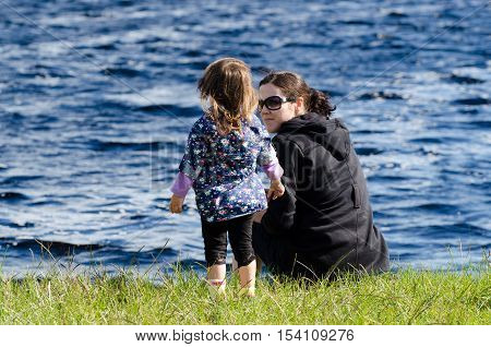 Mothers And Daughters On A Lake