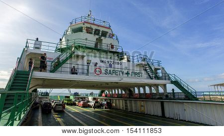 Menumbok,Sabah-Oct 30,2016: Bridge on the ferry with vehicles on board,carries passengers &vehicles from Labuan to Menumbok,Sabah.Most economical trade route that connect Labuan island & the Borneo.