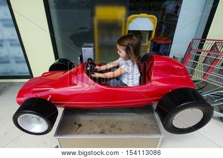 Child Drive A Toy Car
