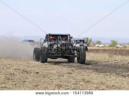 Speeding Black Porter Rally Car Front View