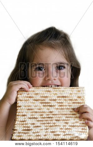 Jewish girl eating a matzo in passover Jewsih holiday.