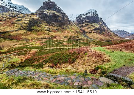 Mountain Footpath Leading To The Peak In Scotland