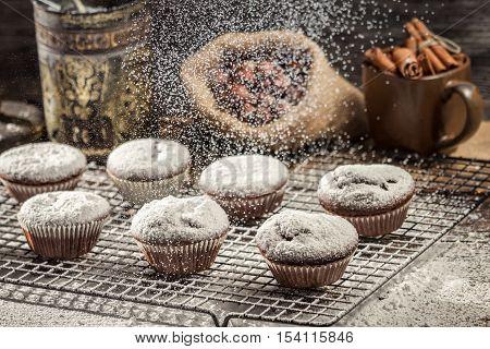 Falling Powder Sugar On Fresh Chocolate Muffins