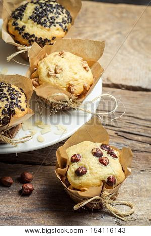 Vanilla Muffin With Nuts Wrapped In Paper
